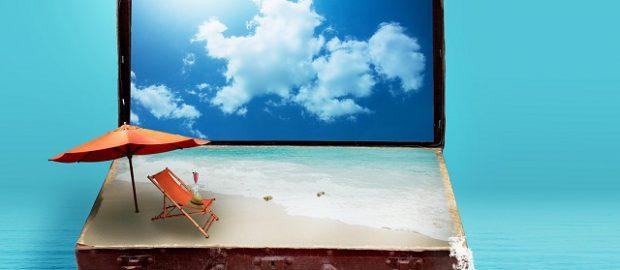 Walizka z plażą, krzesłem i parasolem